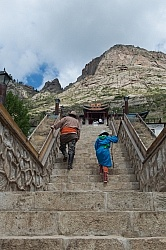 Baagii and Bugiin climb the Stairs to the Monastery