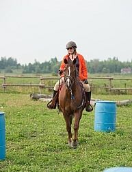 Cinette and Blaze Going Throgh the Barrels at Horse Country Camp