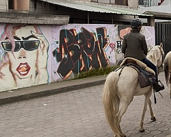 Riding through the Town of Aloag on the way to Bomboli, Ecuador