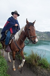 Gabriel riding around  Crater Lake at Quilotoa volcano