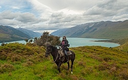Shawn on Hannah on The Ride Out Of Dingleburn Station on the Land of the Long White Cloud Ride with Wild Womens Expeditions and Adventure Horse Trekking New Zealand