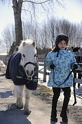 Child Leading Pony