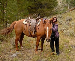 Shawn with her Horse Hobbled at Blue Sky Sage Horse Adventures