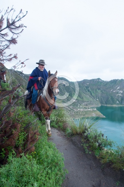 Gabriel a riding around  Crater Lake at Quilotoa volcano